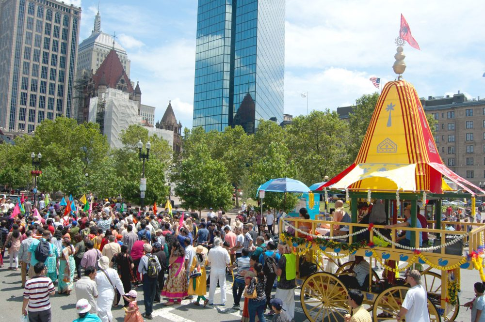 The Festival of Chariots — or Ratha Yatra — passes Copley Square. (Greg Cook/WBUR)
