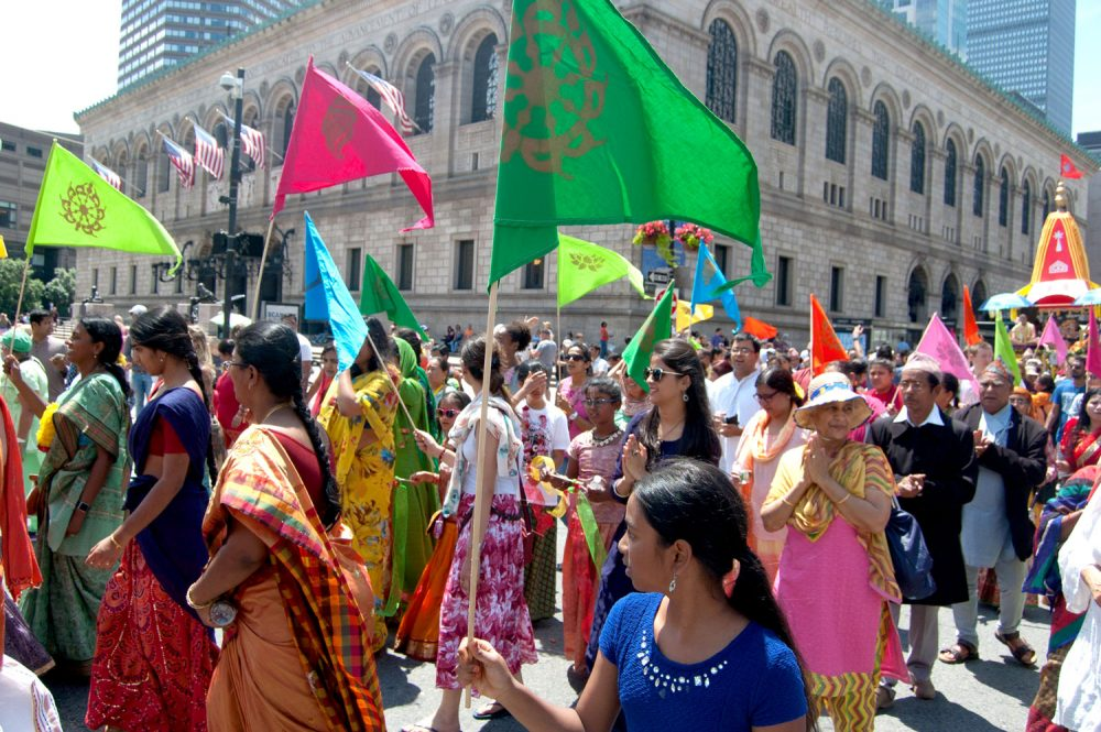 The Festival of Chariots passes the Boston Public Library in Copley Square. (Greg Cook/WBUR)