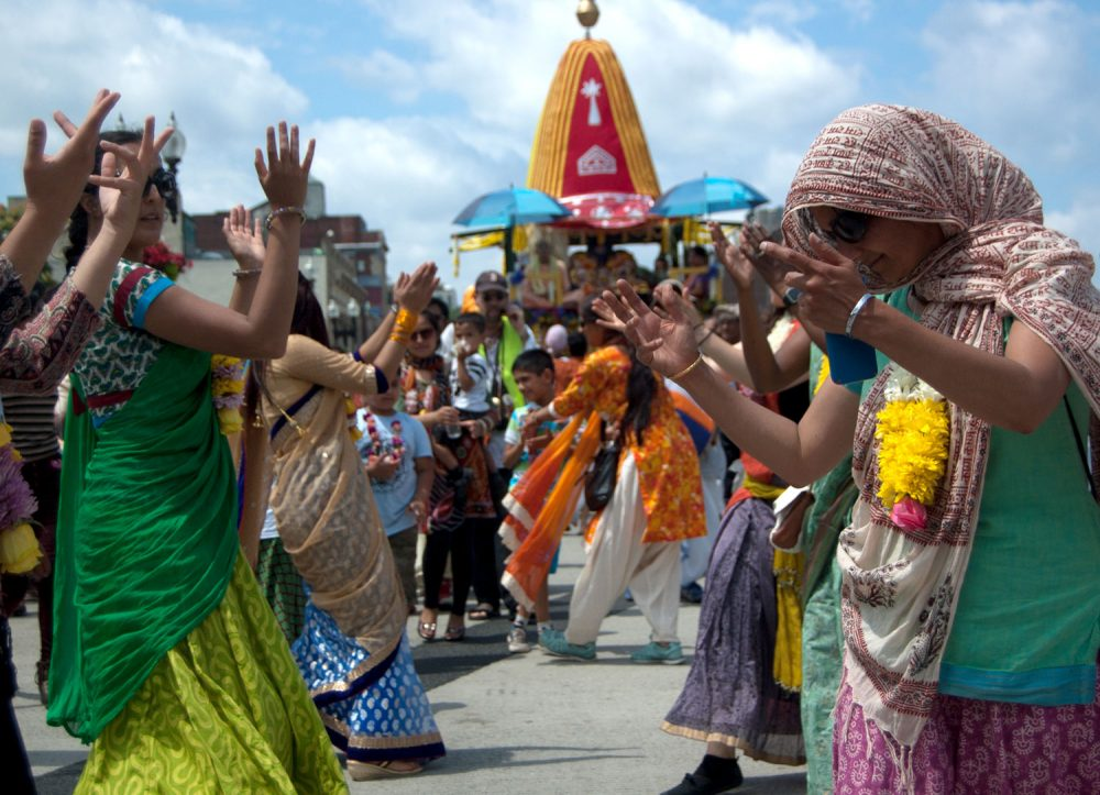 Dancing down Boston's Boylston Street during the Festival of Chariots — or Ratha Yatra. (Greg Cook/WBUR)