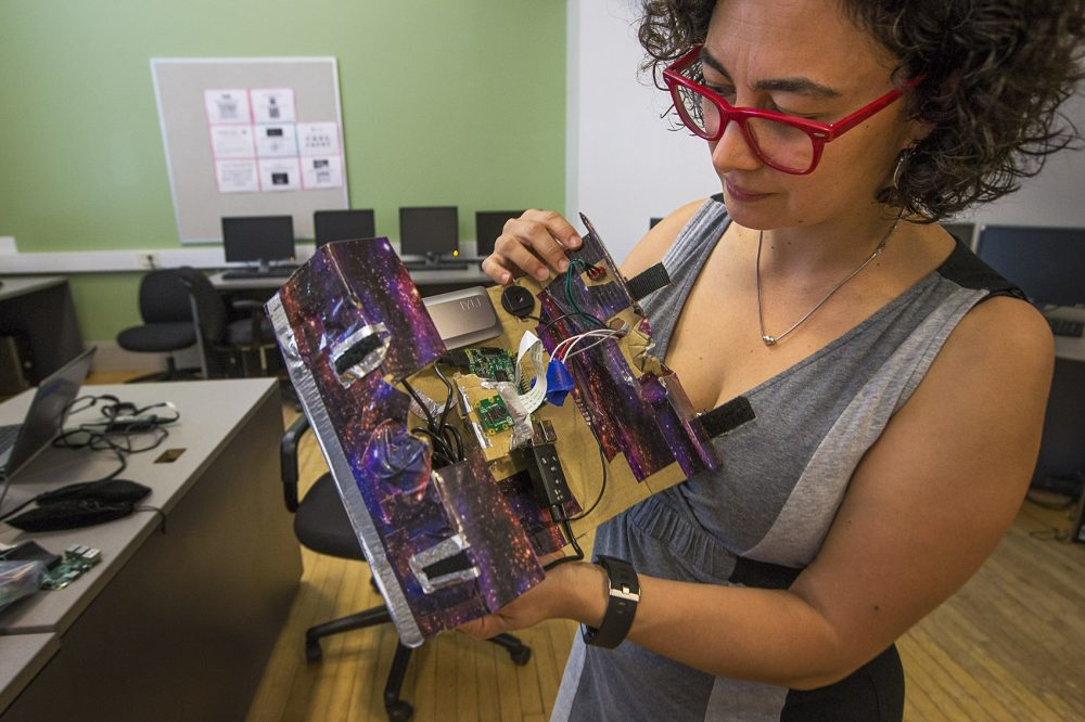 Artist Lina Maria Giraldo demonstrates how to use one of the video cameras created during her program at the Hyde Park Community Center. (Jesse Costa/WBUR)