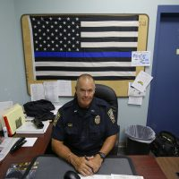 Taunton police Lt. Paul Roderick sits behind his desk at police headquarters in Taunton, Mass. (Stephan Savoia/AP)