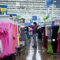 In this June 5, 2014 photo, a woman shops for clothes at a Wal-Mart in Rogers, Ark. (Sarah Bentham/AP)