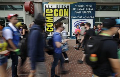 People arrive for the first day of Comic-Con Thursday, July 20, 2017, in San Diego. Comic-Con, which started as a comic-book convention with 300 participants in 1970 and has grown into a corporate-heavy media showcase that draws more than 130,000 attendees, runs through Sunday in San Diego. (Gregory Bull/AP)