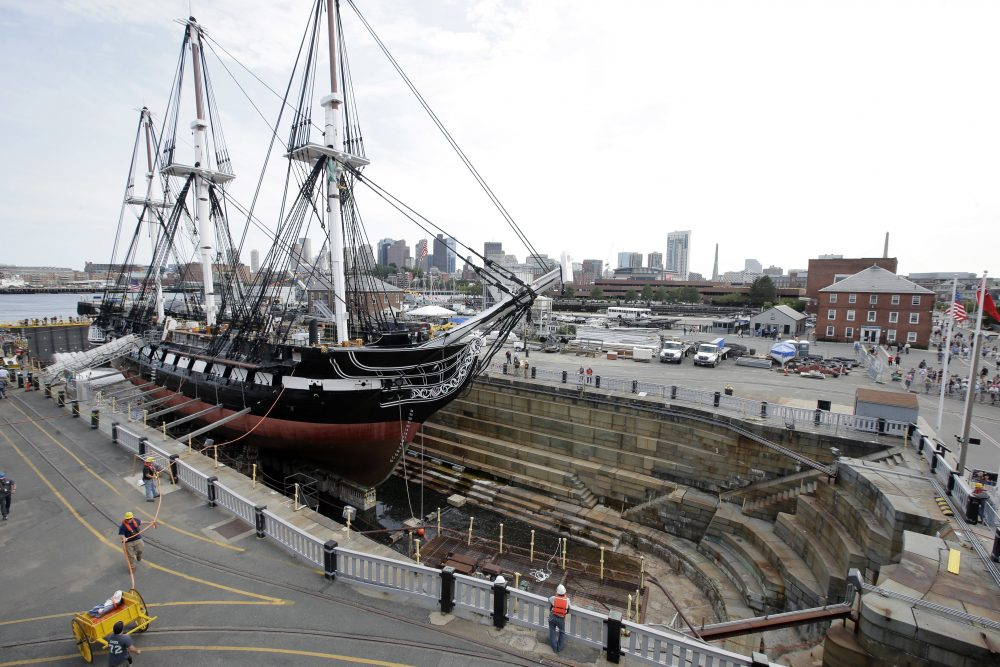 The USS Constitution, also known as Old Ironsides, rests in dry dock as water enters the basin to refloat the vessel on Sunday at Charlestown Navy Yard in Boston. (Steven Senne/AP)