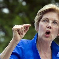 Sen. Elizabeth Warren, D-Mass. speaks in a park in Berryville, Va. Monday, where Congressional Democrats unveiled their new agenda. (Cliff Owen/AP)