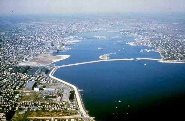 An aerial view of a section of the New Bedford hurricane barrier. The barrier rises 20 feet above the surface of the water, totals 3.5 miles in length, and crosses New Bedford and Fairhaven harbors. (US Army Corps of Engineers)
