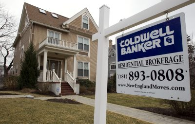 This March 15, 2012 file photo shows a home with a real estate sign in front in Watertown, Mass. (Steven Senne/AP/File)