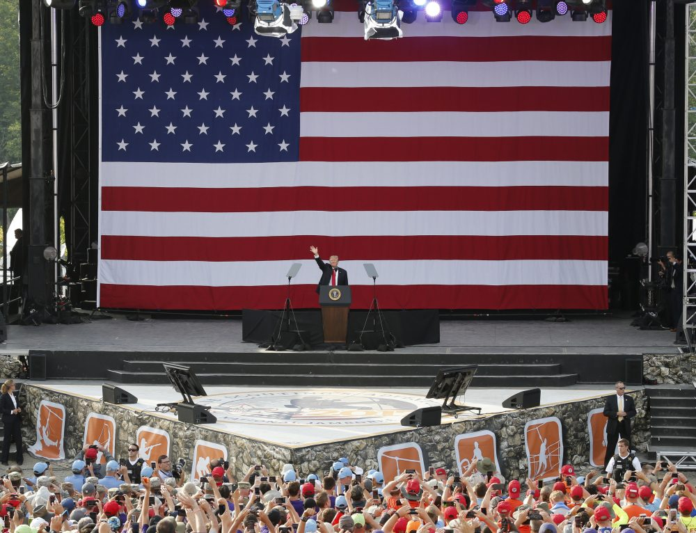 President Trump waves to the crowd of scouts at the 2017 National Boy Scout Jamboree at the Summit in Glen Jean,W. Va., on Monday. (Steve Helber/AP)