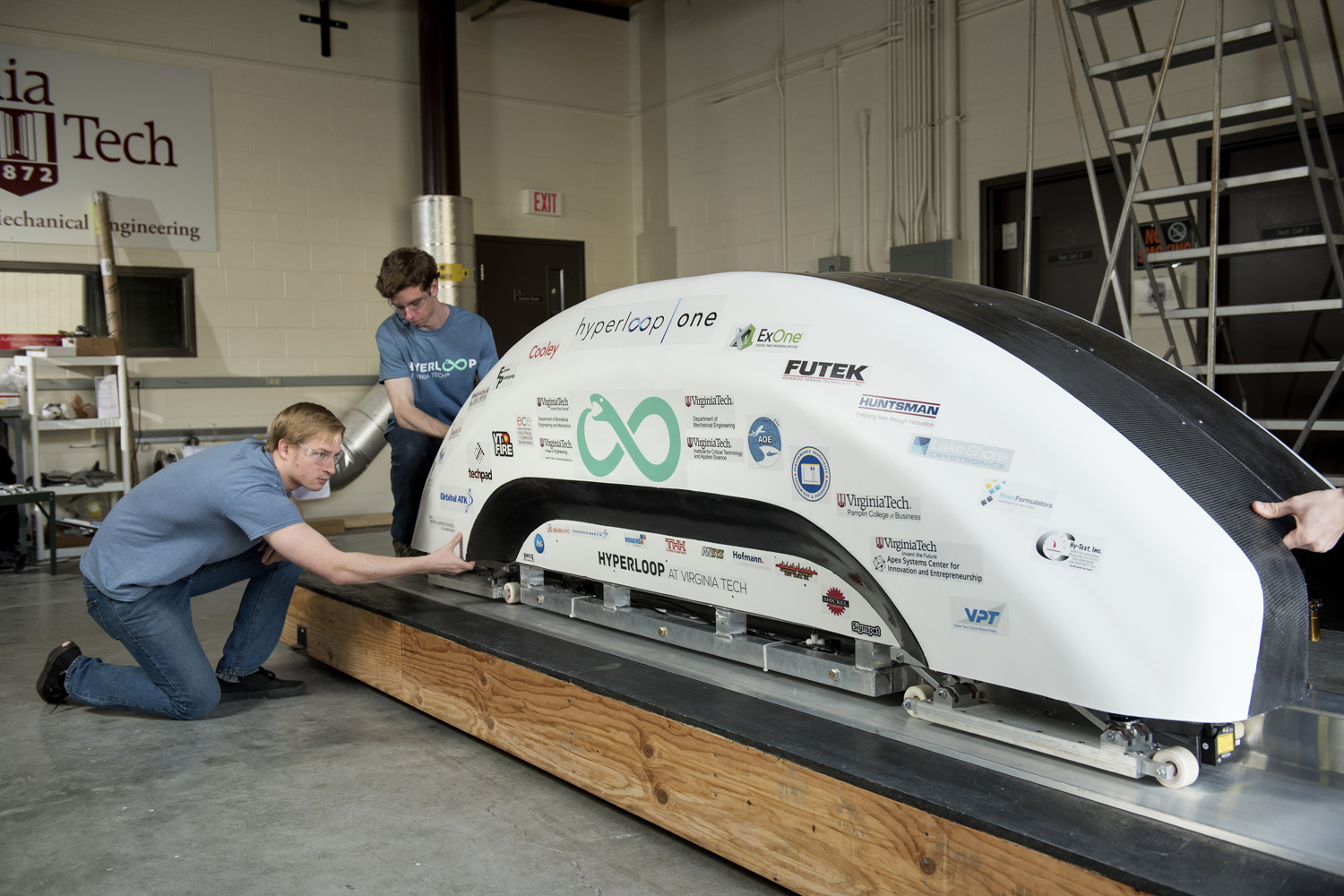 Hyperloop at Virginia Tech team with the final pod they have built for the competition at SpaceX. (Courtesy Virginia Tech College of Engineering)