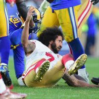 Colin Kaepernick of the San Francisco 49ers reacts after being tackled during the game against the Los Angeles Rams at Los Angeles Memorial Coliseum on December 24, 2016 in Los Angeles, Calif. (Harry How/Getty Images)