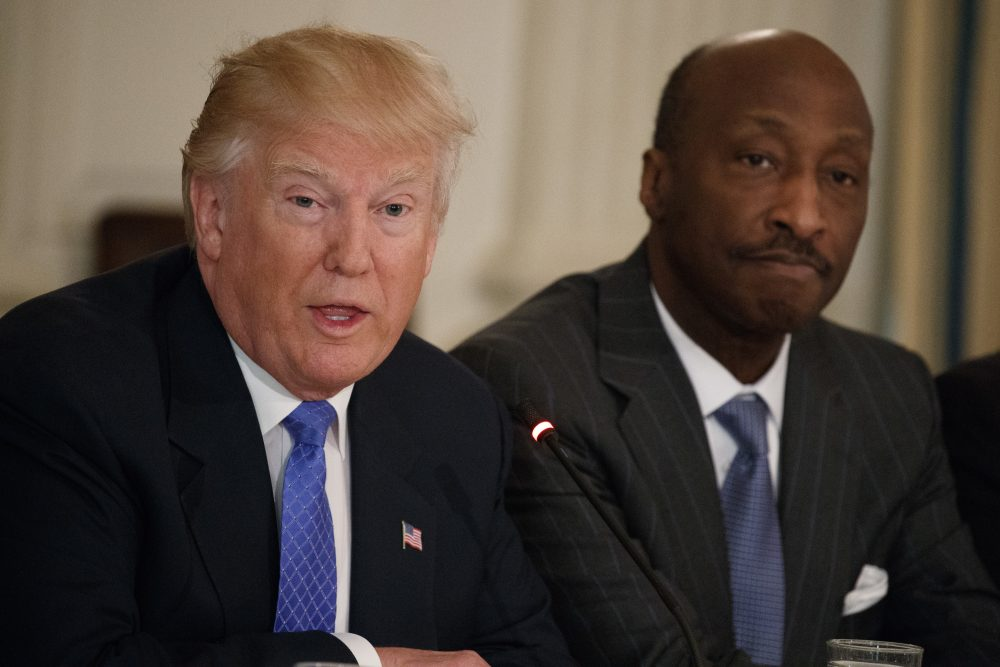 Merck CEO Kenneth Frazier listens at right as President Trump speaks during a meeting with manufacturing executives at the White House in Washington, Feb. 23, 2017. (Evan Vucci/AP)