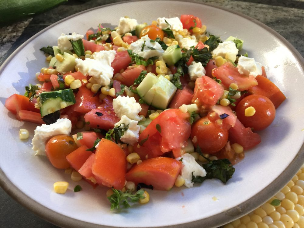 Kathy's sautéed corn salad with tomatoes, cucumber and feta with basil vinaigrette. (Kathy Gunst for Here & Now)