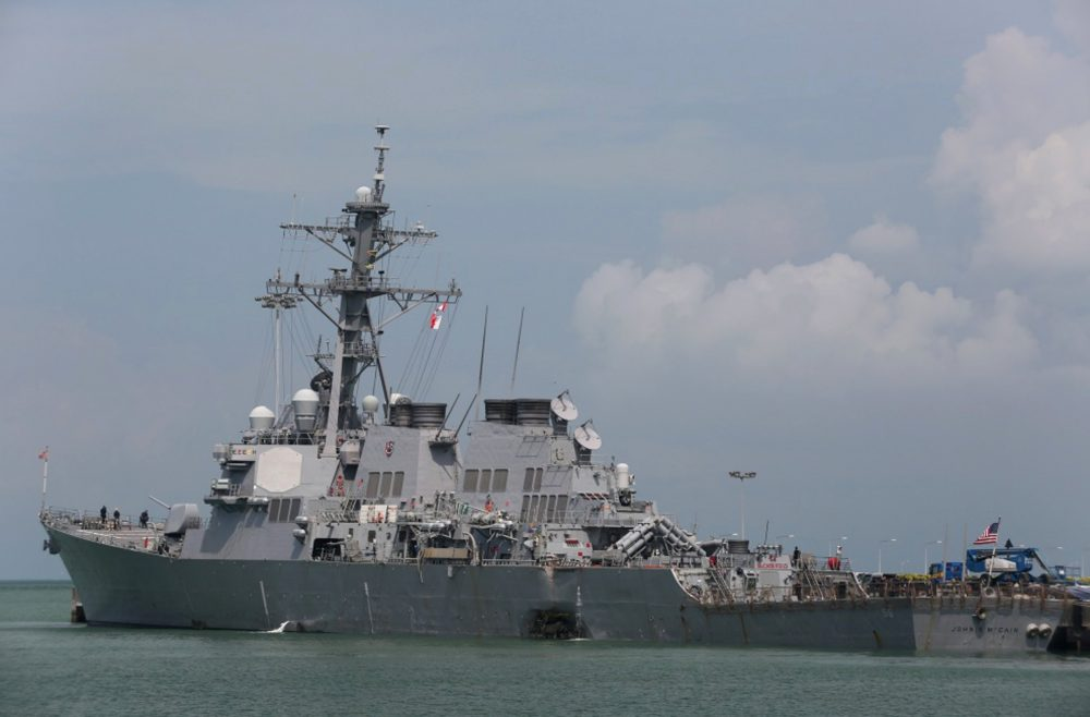 "The guided-missile destroyer USS John S. McCain (DDG 56) is moored pier side at Changi naval base in Singapore following a collision with the merchant vessel Alnic MC Monday, Aug. 21, 2017. The USS John S. McCain was docked at Singapore's naval base with ""significant damage"" to its hull after an early morning collision with the Alnic MC as vessels from several nations searched Monday for missing U.S. sailors. (Grady T. Fontana/U.S. Navy photo via AP)"