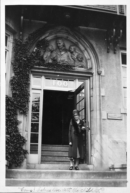 Lucy Wheelock stands in front of the Froebel Frieze in the 1930s. (Courtesy of Wheelock College Archives/Flickr)