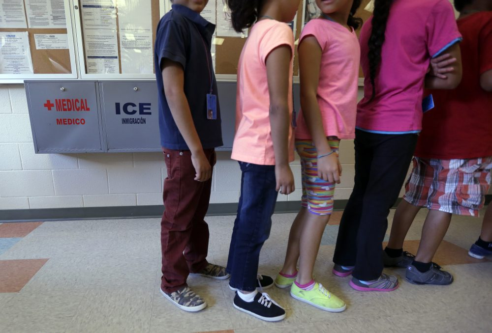 In this Sept. 10, 2014 file photo, detained immigrant children line up in the cafeteria at the Karnes County Residential Center, a temporary home for immigrant women and children detained at the border in Karnes City, Texas. (Eric Gay/AP)