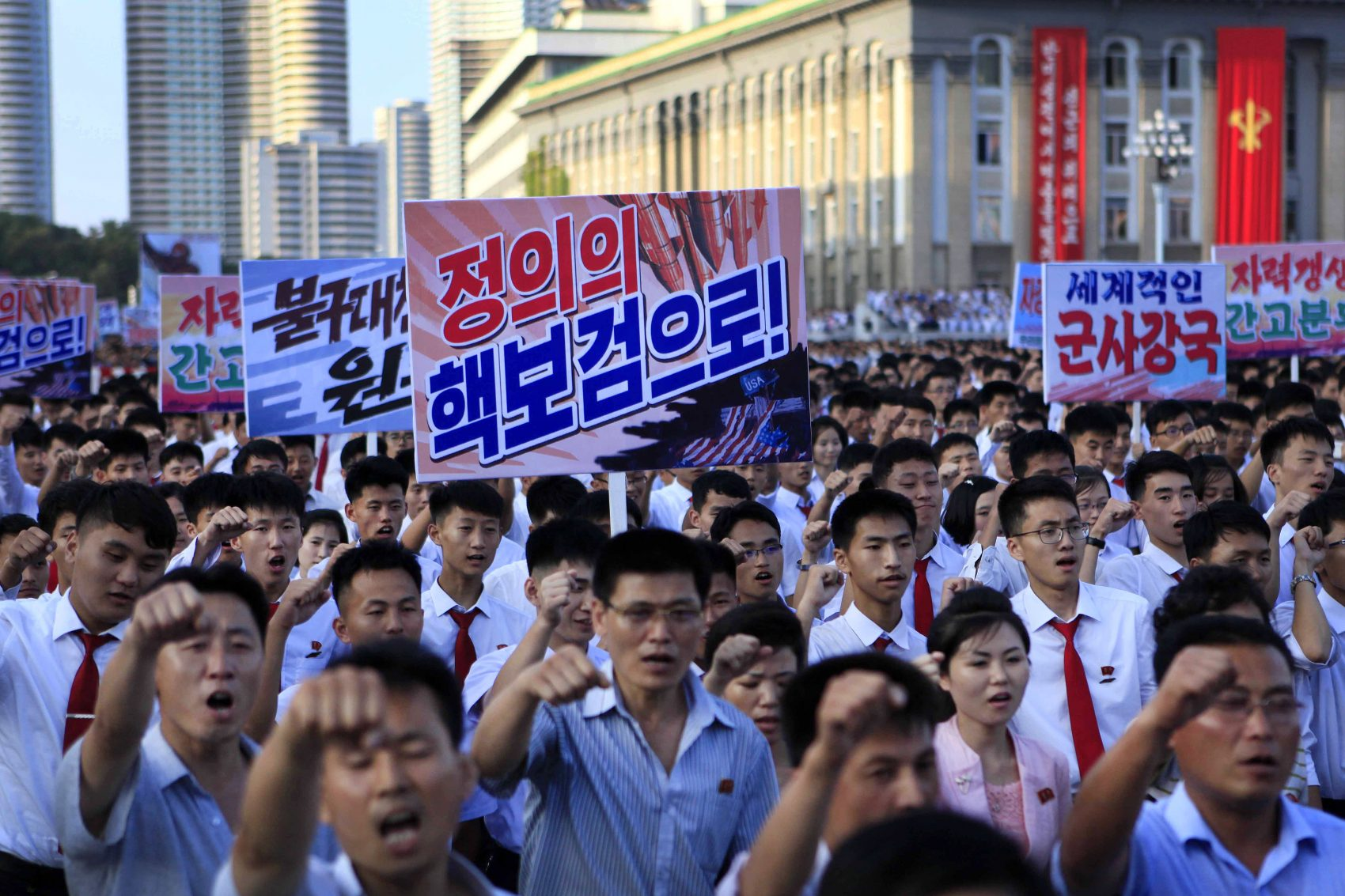 North Koreans gather for a rally at Kim Il Sung Square as a show of support for their rejection of the United Nations' latest round of sanctions on Wednesday Aug. 9, 2017, in Pyongyang, North Korea. (Jon Chol Jin/AP)