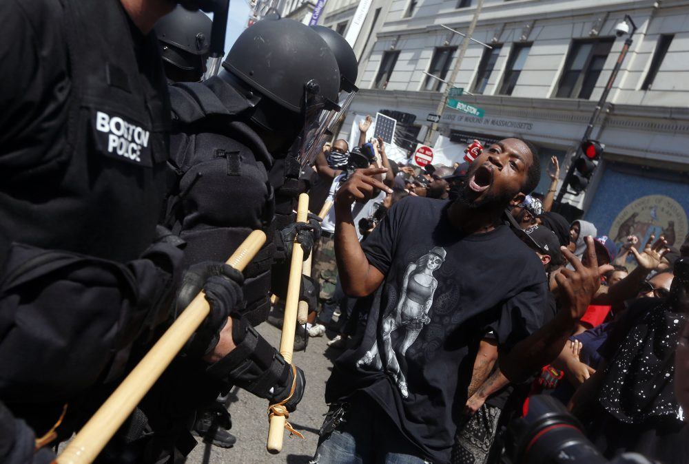 Police move toward a counter-protester. (Michael Dwyer/AP)