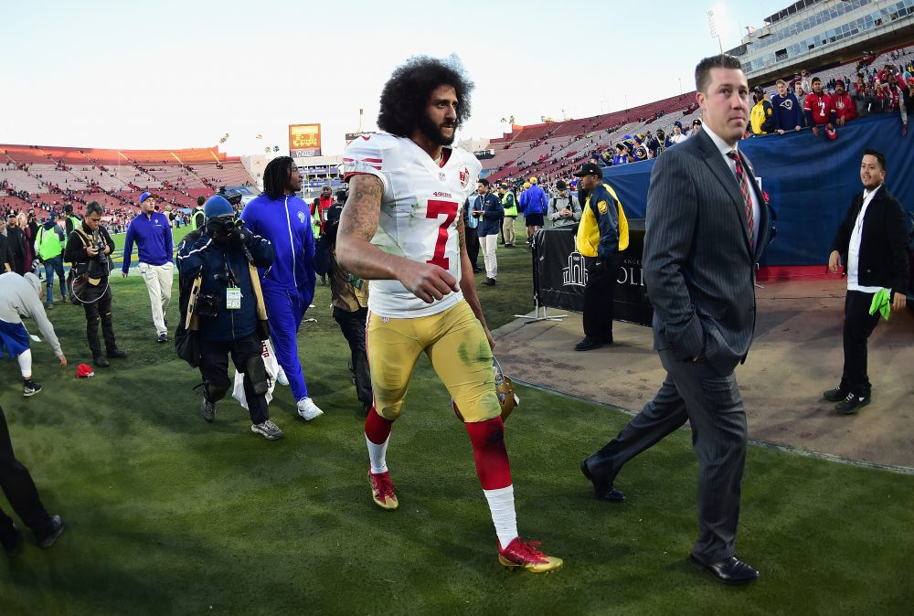 LOS ANGELES, CA -  Colin Kaepernick of the San Francisco 49ers walks off the field in December 2016. Some feel he's being ridden out of football by colluding owners who didn't like his taking a knee during the national anthem before games. (Photo by Harry How/Getty Images)