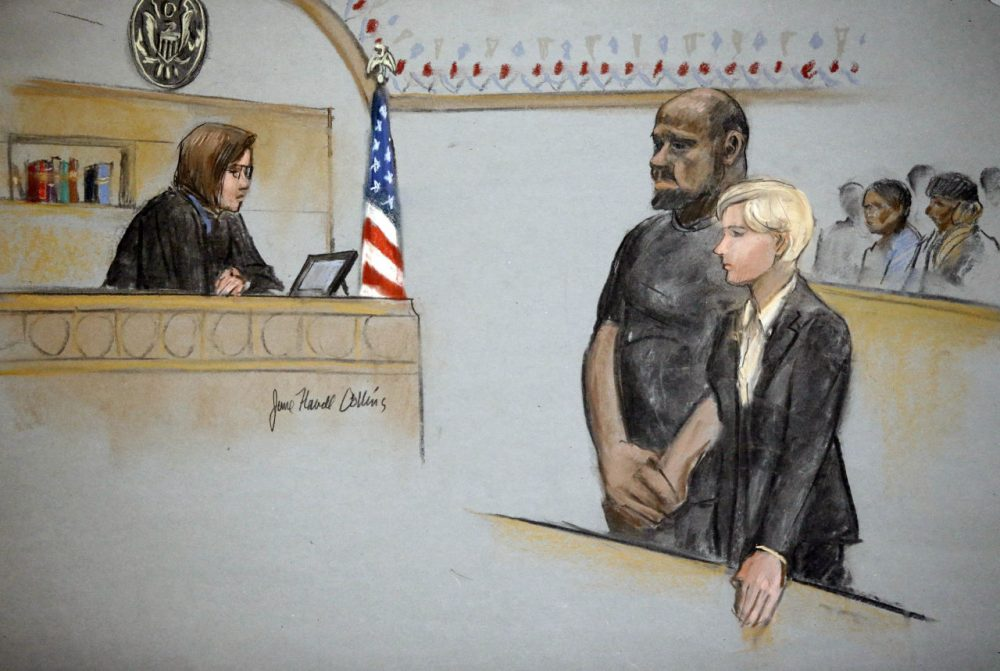 In this courtroom sketch, David Wright, second from left, is depicted standing with his attorney during a 2015 hearing in federal court in Boston. (Jane Flavell Collins/AP)