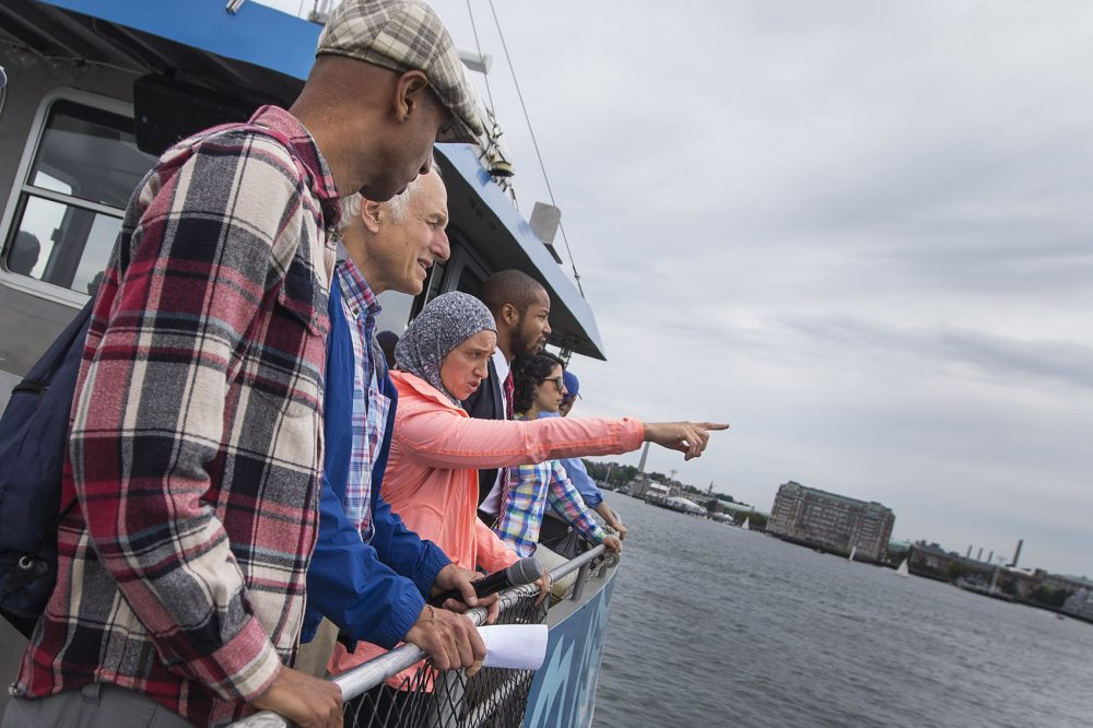 Ayed, center, speaks to a group of climate advocates during a boat tour of Boston Harbor. (Jesse Costa/WBUR)