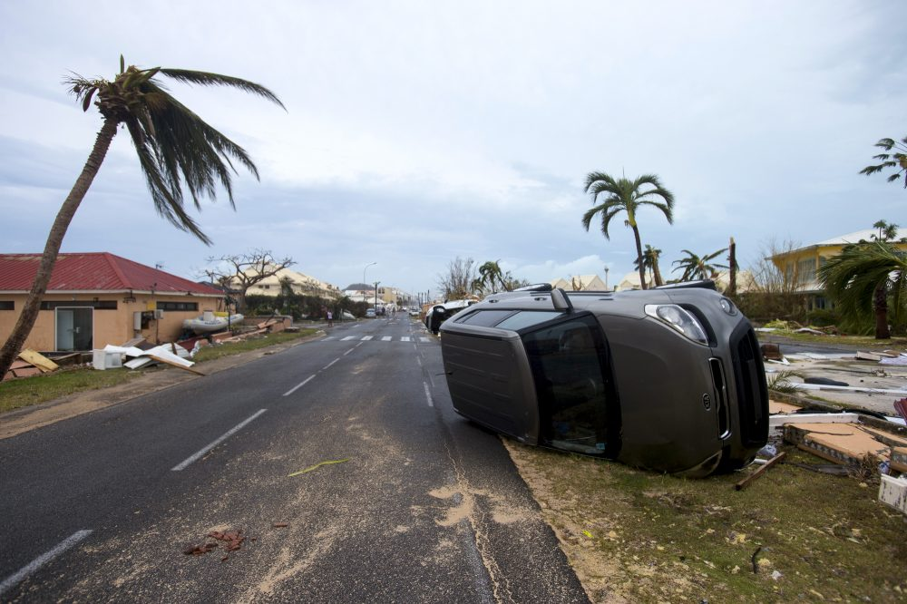 A photo taken on Sept. 6, 2017, shows a car turned onto its side in Marigot, near the Bay of Nettle, on the French Collectivity of Saint Martin after the passage of Hurricane Irma. (Lionel Chamoiseau/AFP/Getty Images)