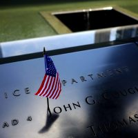 A United States flag is seen on a name at the Sept. 11 Memorial, Friday, June 30, 2017, in New York. (Julio Cortez/AP)