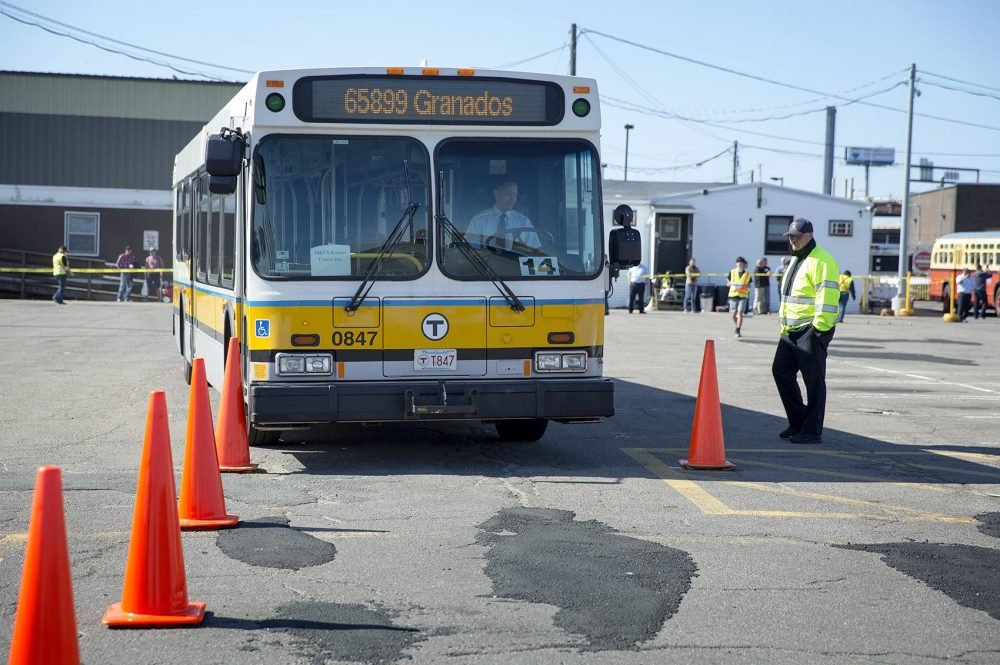 A contestant guides his bus between cones at the MBTA Roadeo in Charlestown. (Robin Lubbock/WBUR)