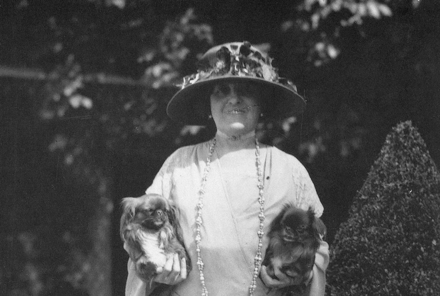 Edith Wharton photographed at her home in France with her two pet Pekingese dogs in the 1920s. (Courtesy Granger Historical Picture Archive/Alamy)