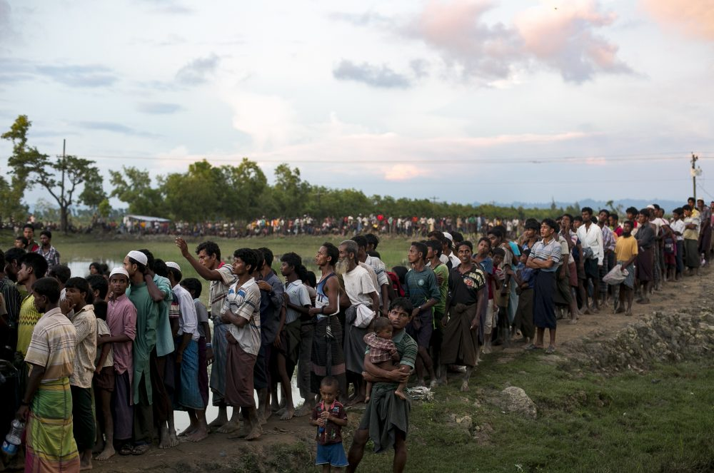 Recently arrived Rohingya refugees wait to receive aid donations on Sept. 13, 2017, in Cox's Bazar, Bangladesh. Around 370,000 Rohingya refugees have fled into Bangladesh since late August during the outbreak of violence in the Rakhine state. (Allison Joyce/Getty Images)