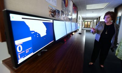 Margaret Vinci, manager at the Seismological Laboratory at Caltech, gestures toward a row of ShakeAlert user display screens monitoring California quake activity in Pasadena, Calif., on June 1, 2017. (Frederic J. Brown/AFP/Getty Images)