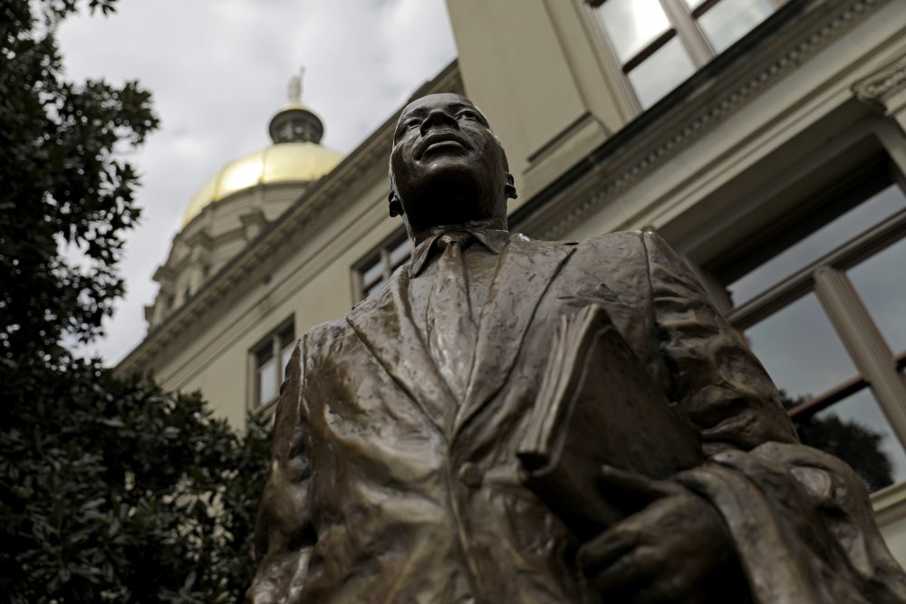 "A statue paying tribute to civil rights leader Martin Luther King Jr. is unveiled on the state Capitol grounds in Atlanta on Aug. 28. It was unveiled on the 54th anniversary of King's ""I have a dream"" speech. (David Goldman/AP)"