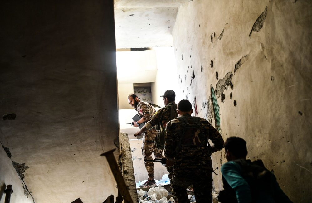 Members of the Syrian Democratic Forces climb up a stairwell during a battle against Islamic State group jihadists to retake the central hospital of Raqqa on the western frontline of the city on Sept. 28, 2017. Syrian fighters backed by U.S. special forces are battling to clear the last remaining Islamic State group jihadists holed up in their crumbling stronghold. (Bulent Kilic/AFP/Getty Images)