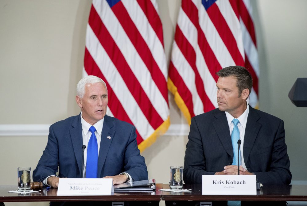 Vice President Mike Pence, left, the chair of the Presidential Advisory Commission on Election Integrity, accompanied by the vice chair, Kansas Secretary of State Kris Kobach, speaks during the commission's first meeting at the White House in July. (Andrew Harnik/AP)