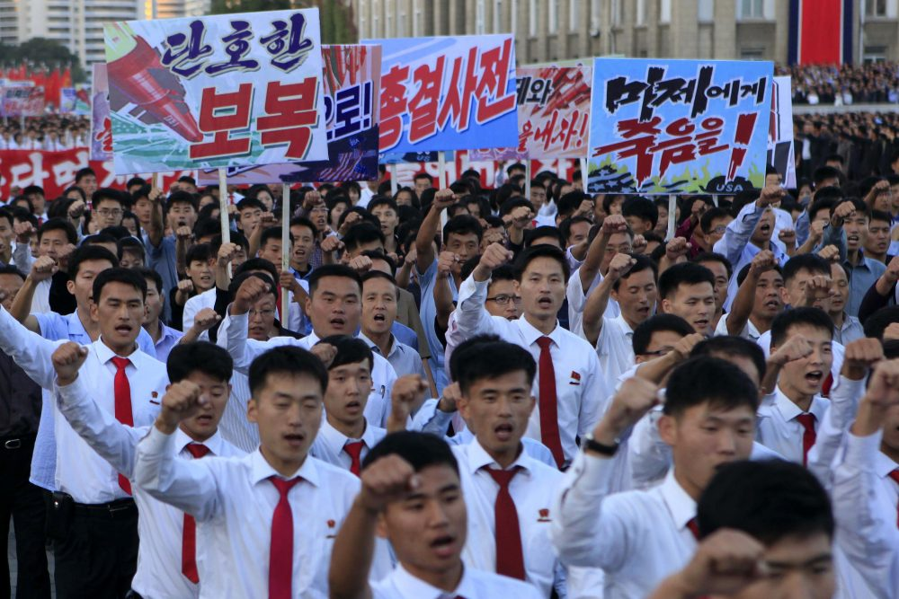 "North Koreans gather at Kim Il Sung Square to attend a mass rally against America on Saturday, Sept. 23, 2017, in Pyongyang, North Korea, a day after the country's leader issued a rare statement attacking Donald Trump. The sign on the left reads ""decisive revenge"" and the sign on the right reads ""death to the American imperialists."" (Jon Chol Jin/AP)"