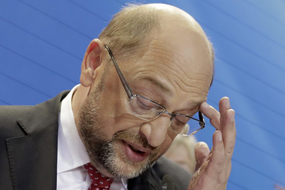 "Party chairman and top candidate Martin Schulz addresses his supporters in the headquarters of the Social Democratic party in Berlin, Germany, Sunday, Sept. 24, 2017, after the polling stations for the German parliament elections had been closed. The sign reads: ""It's Time."" Schulz conceded defeat to Merkel. (Gero Breloer/AP)"
