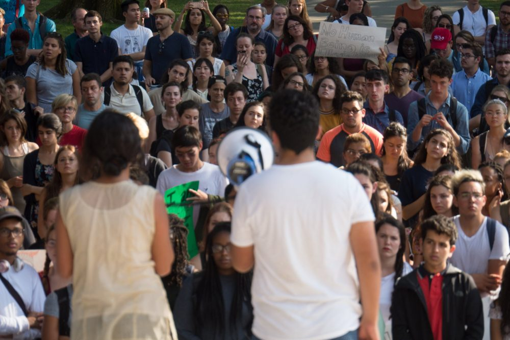 Bruno Villegas and another student speak about DACA before a crowd in Harvard Yard. (Max Larkin/WBUR)