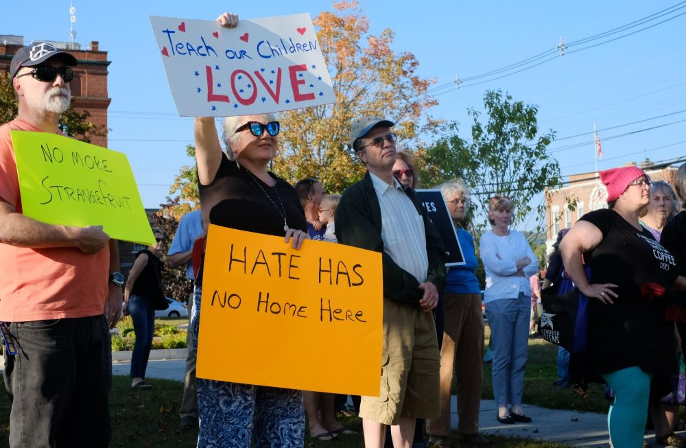 Tuesday's vigil in Claremont, organized by local residents, drew a crowd from across the area. (Britta Greene/NHPR)