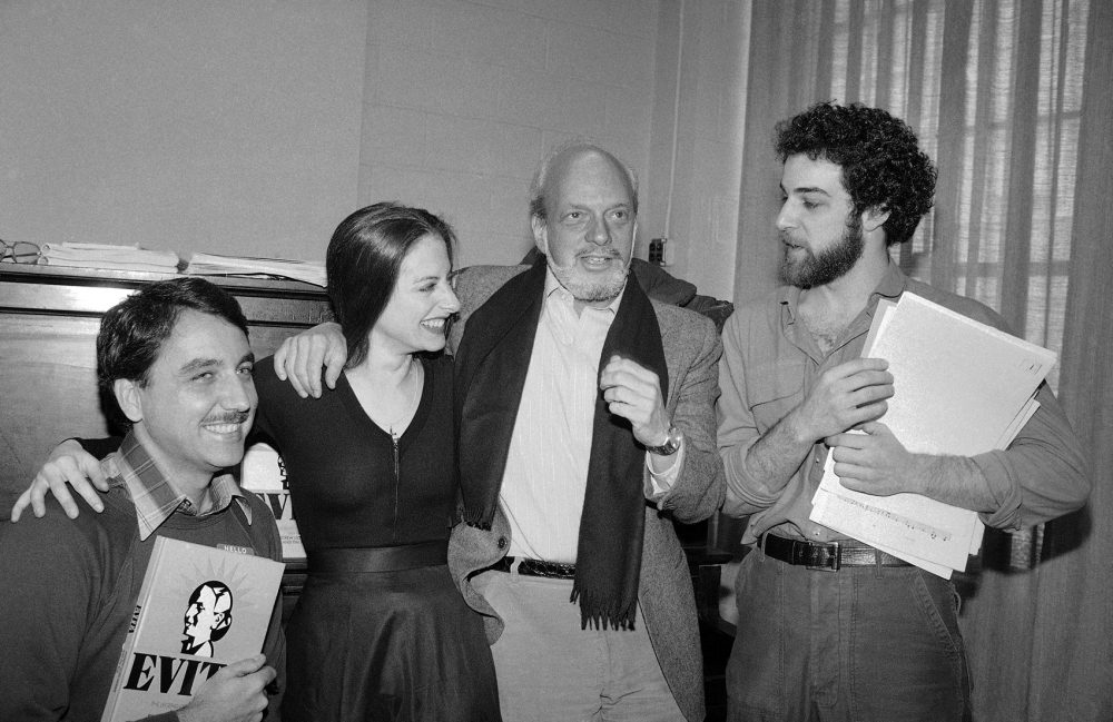"The director and leads of the 1979 Broadway production of ""Evita,"" from left: Bob Gunton, who played Juan Peron; Patti LuPone, who played Evita; director Hal Prince; and Mandy Patinkin, who played ""Che."" (Marty Lederhandler/AP)"