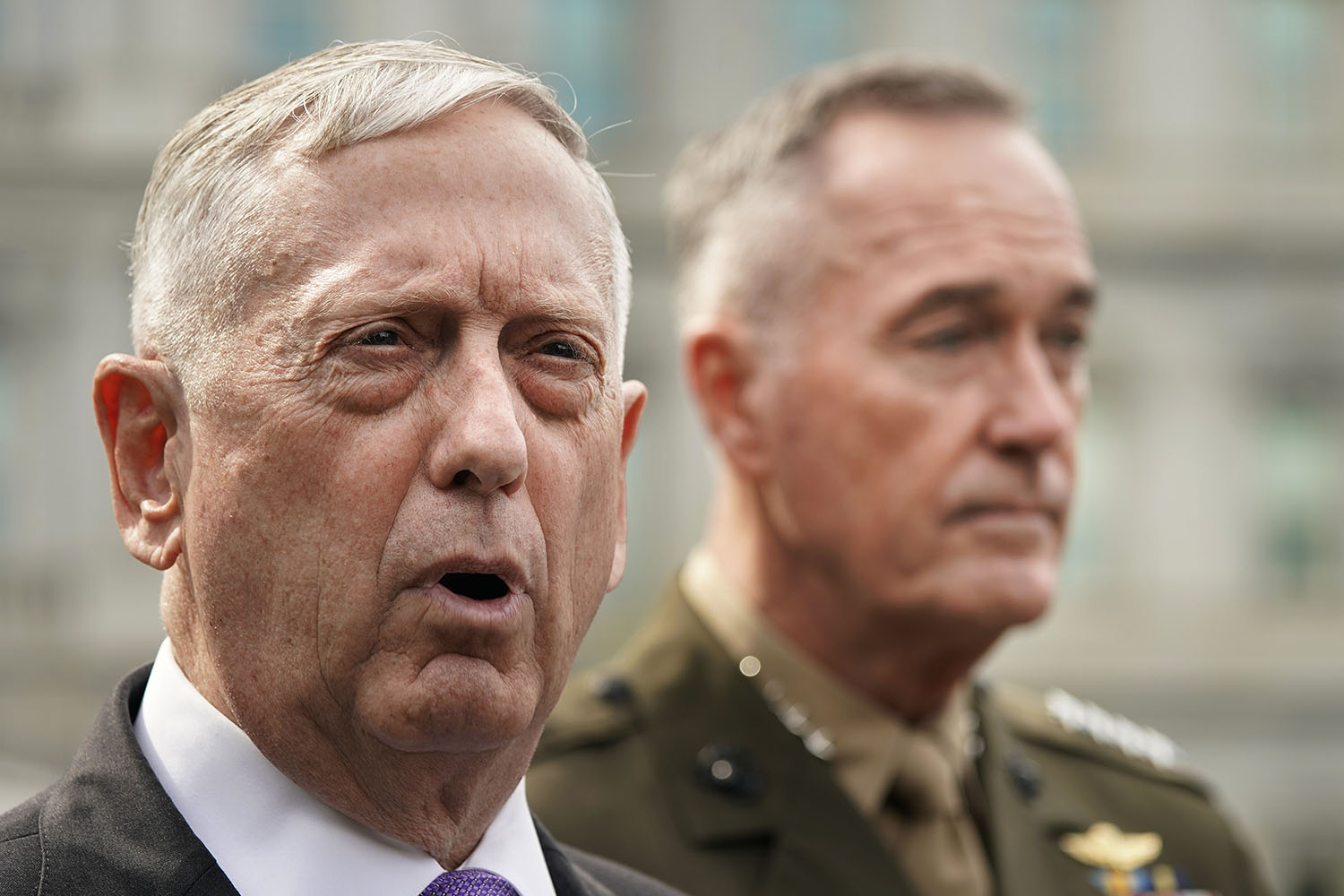 Defense Secretary Jim Mattis, left, accompanied by Joint Chiefs Chairman Gen. Joseph Dunford, right, speaks to members of the media outside the West Wing of the White House in Washington, Sunday, Sept. 3 regarding the escalating crisis in North Korea's nuclear threats. (Pablo Martinez Monsivais/AP)