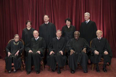 In this June 1 file photo, the justices of the U.S. Supreme Court gather for an official group portrait. Ruth Bader Ginsburg, 84, is at left. (J. Scott Applewhite/AP)