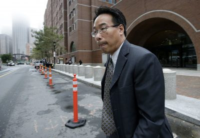 Glenn Chin, the supervisory pharmacist at the now-closed New England Compounding Center, departs federal court after attending the first day of his trial on Sept. 19. (Steven Senne/AP)