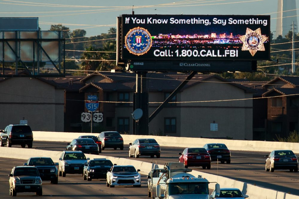 Vehicles drive past a billboard featuring a Federal Bureau of Investigation tip line phone number on Interstate 515, Oct. 7, 2017, in Las Vegas. (Drew Angerer/Getty Images)