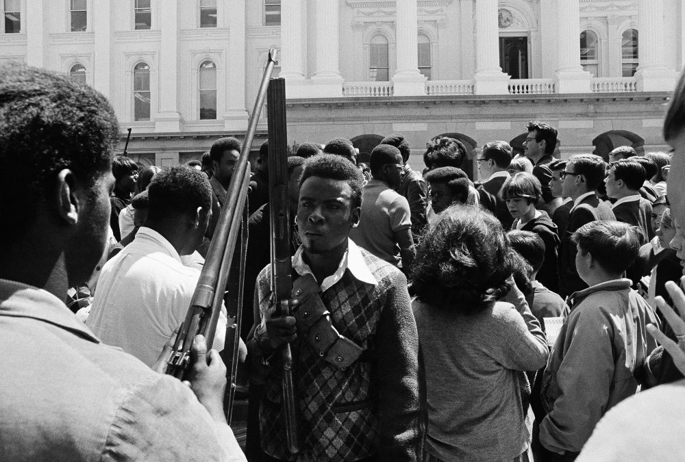 Armed members of the Black Panther Party leave the Capitol in Sacramento on May 2, 1967. (AP)