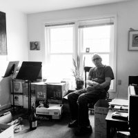 "Richard Alan White, in his Milford, N.H., apartment, where he completed his opera ""Hester."" (Courtesy Rebecca White)"