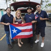 Richard Toledo of Revere, Dericka Avecedo of Danvers, Arnoldo Ortiz of Everett, and Humberto Rivera of Worcester are delivering supplies donated from the Boston area to cities and towns around Puerto Rico. (Jesse Costa/WBUR)
