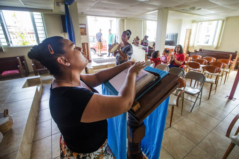 A small group of women and children rehearse traditional Puerto Rican evangelical Plana music in a community hall in the Barrio Obrero Santurce neighborhood in San Juan. (Jesse Costa/WBUR)