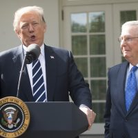 President Trump speaks to the press alongside Senate Majority Leader Mitch McConnell (R-Ky.) in the Rose Garden of the White House in Washington, D.C., on Oct. 16, 2017. (Saul Loeb/AFP/Getty Images)