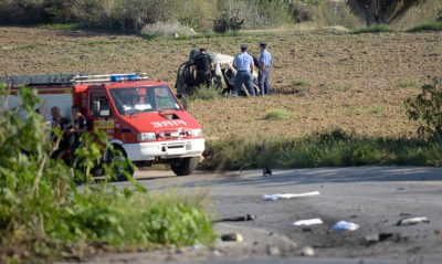 Police inspect the wreckage of a car bomb believed to have killed journalist and blogger Daphne Caruana Galizia close to her home in Bidnija, Malta on Oct. 16, 2017. The force of the blast broke her car into several pieces and catapulted the journalist's body into a nearby field, witnesses said. She leaves a husband and three sons. Caruana Galizia's death comes four months after Prime Minister Joseph Muscat's Labour Party won a resounding victory in a general election he called early as a result of scandals to which Caruana Galizia's allegations were central. (Str/AFP/Getty Images)