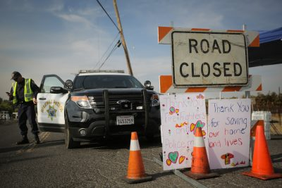 Handmade signs are seen attached to a road closure sign on Oct. 16, 2017 in Oak Knoll, Calif. (Elijah Nouvelage/Getty Images)