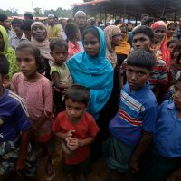 Rohingya Muslim refugees wait for relief supplies at Thaingkhali refugee camp in Ukhia on Oct. 20, 2017. Some 582,000 Rohingya refugees have fled their homes in Myanmar and arrived in Bangladesh since late August, the United Nations said Oct. 17, warning that thousands more were stranded at the border. (Tauseef Mustafa/AFP/Getty Images)
